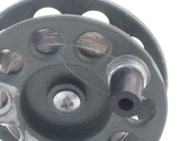 Чтобы избежать перехлеста - надо создать эксцентрик тяжести, тогда катушка, после прекращения потяжки будет ещё делать 1-2 оборота и останавливаться.